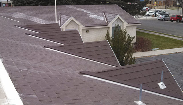 An Example Of Our SnoFree™ Heated Valley Systems Installed On A Shingle Roof .