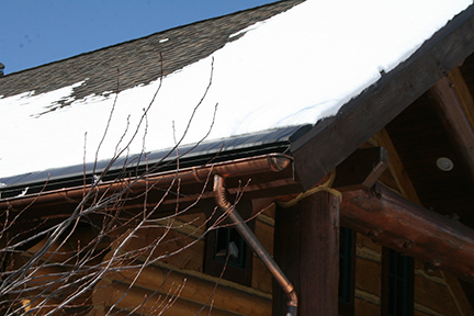 "This snow covered shingle roof can benefit from the addition of SnoFree™ 12"" eave roof panels."