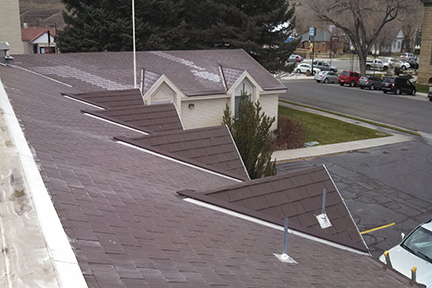"An example of the SnoFree™ 4"" or 6"" Existing Valley Panel installed on a shingle roof."