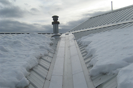 "An example of the SnoFree™ 4"" or 6"" Existing Valley Panel installed on a metal roof."