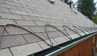 An example of zig zag roof heat cables installed on a shingle roof.